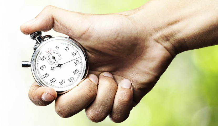 bigstock-hand-holding-stopwatch-against-26151797-e1389549787488-1024x596